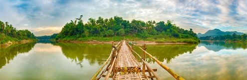 Beautiful view of a bamboo bridge. Laos landscape. Panorama Stock Photos