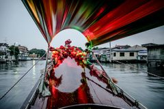 Beautiful view of bangkok canal from wooden long tail boat with colored flowers and amazing light Royalty Free Stock Photo