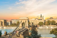 Beautiful view of the Basilica of Saint Istvan and the Szechenyi chain bridge across the Danube in Budapest, Hungary royalty free stock photos