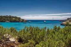 Beautiful view of the bay with turquoise water and yachts in Cala Mondrago National Park on Mallorca island, Spain. Beautiful view of the bay and yachts in Cala Stock Photos