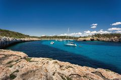 Beautiful view of the bay with turquoise water and yachts in Cala Mondrago National Park on Mallorca island. Spain Stock Photo