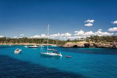 Beautiful view of the bay with turquoise water and yachts in Cala Mondrago National Park on Mallorca island. Spain Royalty Free Stock Image
