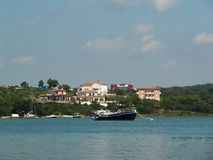 Beautiful view of the Bay where ships and boats are moored near the shore with typical European villas stock image