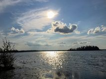 A beautiful view from the beaches of Astotin Lake as the sunsets. In Elk Island National Park, Alberta, Canada stock image