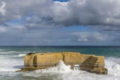 Beautiful view of the big rock called The Bakers Oven on a windy sunny day, Great Ocean Road, Australia. Oceania royalty free stock photo