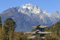 Beautiful view of the Black Dragon Pool and Jade Dragon Snow Mountain in Lijiang, Yunnan - China Royalty Free Stock Image
