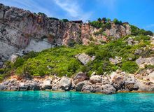 Beautiful view on rock arces arches of Blue caves from sightseeing boat with tourists in blue water of Ionian Sea inside cave, Isl. Beautiful view on Blue Caves Stock Photography