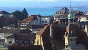 Beautiful view of blue Lake Geneva, red roofs and Gothic spires in Lausanne. Stock footage stock video footage