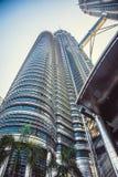 Beautiful view on blue sky of Petronas Twin Towers in Kuala Lumpur. Malaysia. Asia Royalty Free Stock Image