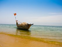 Beautiful view of a boat in the water in a sunny day, in Vietnam. Hoian is recognized as a World Heritage Site by UNESCO Royalty Free Stock Image