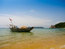 Beautiful view of a boat in the water in a sunny day, in Vietnam. Hoian is recognized as a World Heritage Site by UNESCO Royalty Free Stock Images