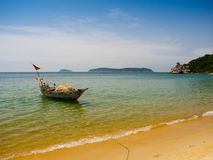 Beautiful view of a boat in the water in a sunny day, in Vietnam. Hoian is recognized as a World Heritage Site by UNESCO Stock Photo