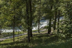 Beautiful view of the Boite river with open sediment from rosk  and mountain in Cortina d`Ampezzo, Dolomite mountains,    Alps. Beautiful view of the Boite river Royalty Free Stock Images
