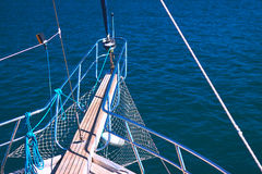 Beautiful view from a bow of yacht at seaward. Forage yacht on background of ocean waves Stock Images