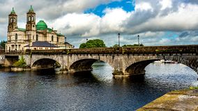 Beautiful view of the bridge over the river Shannon, the parish church of Ss. Peter and Paul in Athlone town. Beautiful view of the bridge over the river Shannon royalty free stock images