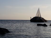 Sailing boat in sight stock photography