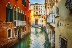Beautiful view on canal with boats in Venice on sunset, Italy royalty free stock images