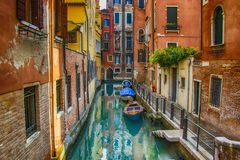 Beautiful view on canal with boats in Venice on sunset, Italy royalty free stock photography