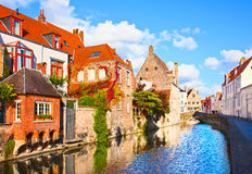 Beautiful view of a canal and , bridge, red roofs in Bruges, Bel Royalty Free Stock Photos