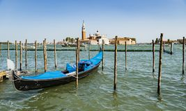 Beautiful view of the canal with a floating gondola Royalty Free Stock Photo