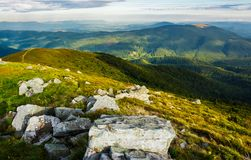 Beautiful view of Carpathians in dappled light. Wonderful colors of summer landscape in mountains on a cloudy day observed from the top of a hill. location Royalty Free Stock Photos