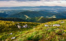 Beautiful view of Carpathians in dappled light. Wonderful colors of summer landscape in mountains on a cloudy day observed from the top of a hill. location Stock Photography