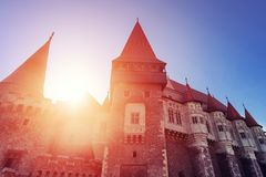 Beautiful view of castle with wooden bridge and high towers royalty free stock image
