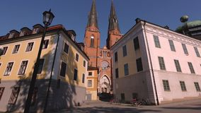 Beautiful view on cathedral church between old buildings on blue sky background. Europe.Sweden. stock video footage