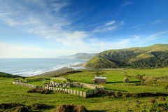 Beautiful view of  cattle ranch and green hills along Pacific ocean. Beautiful view of ranch and green hills along Pacific ocean Royalty Free Stock Photography