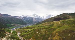 Beautiful view of Caucasus mountains. Beautiful view of the snow-covered and vegetated Caucasus mountains royalty free stock images