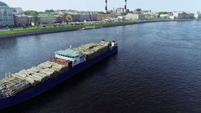 Beautiful view of city and cargo ship on river in summer day. Beautiful view of city and cargo ship on river in summer day, port city with buildings and moving stock video footage