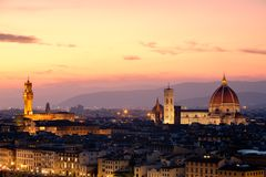 The city of Florence at sunset with the famous Duomo and the Palazzo Vecchio. Beautiful view of the city of Florence at sunset with the famous Duomo and the Royalty Free Stock Photography