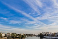 Beautiful view of the city and the Guadalquivir river in Seville Spain. On a beautiful sunny day with a blue sky in the background stock photo