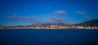 Beautiful view of the city in the horizont from ferry between north and south island in New Zealand, sailing into Picton Stock Photo