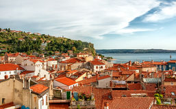 Beautiful view of the city of Piran, Slovenia on a Sunny day with beautiful cloud on the sky. Royalty Free Stock Images