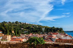 Beautiful view of the city of Piran, Slovenia on a Sunny day with beautiful cloud on the sky. The horizontal frame. Royalty Free Stock Image