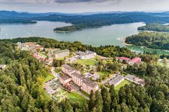 Solina, Polanczyk aerial view. Beautiful view of city Polanczyk in Bieszczady from the drone with lake Solina behind royalty free stock photography