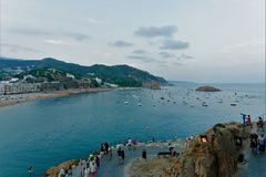 Tossa de Mar, Spain, August 2018. Walking people on the road to the old fortress in the evening twilight. royalty free stock image