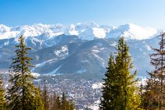 A beautiful view of the city of Zakopane lying at the foot of the Polish Tatra Mountains. Sunny, beautiful day in the winter, snow royalty free stock image