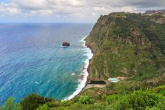 Madeira coastline view hiking. Beautiful view of the coastline of the island Madeira with vibrant green nature and blue ocean during a levada hike stock photos