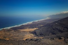 Beautiful view of the Cofete beach in Fuerteventura in the Canary Islands, Spain. It is longest beach of Europe. It is natural stock photo