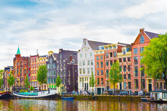 Beautiful view of the Colorful okd facades building in Amsterdam. Beautiful view of the Colorful okd facades historic buildings in Amsterdam. Amsterdam is the royalty free stock photos