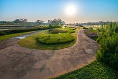 View of the curved route with green meadow and trees in the mor. Beautiful view of the curved route with green meadow and trees in the morning in Chiang Rai stock image