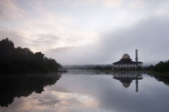 Beautiful view of Darul Quran Mosque with reflections during sunrise Stock Photos