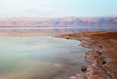Beautiful view of Dead Sea shore with clear water. Ein Bokek, Israel. Beautiful view of salty Dead Sea shore with clear water. Ein Bokek, Israel royalty free stock photo