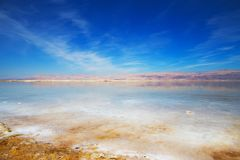Beautiful view of Dead Sea shore with clear water. Ein Bokek, Israel. Beautiful view of salty Dead Sea shore with clear water. Ein Bokek, Israel stock photography
