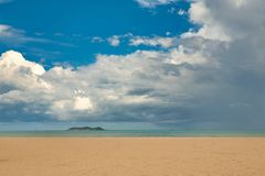 Beautiful view of the deserted beach, the sea and the blue sky on the island of Hainan. royalty free stock image