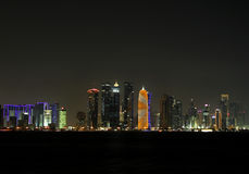 Beautiful view of Doha skyline at night, Qatar. Beautiful view of Doha skyline at night, modern highrise building in Qatar Royalty Free Stock Images