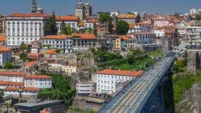 Beautiful view of the Douro River timelapse and. The embankment of the historic centre of Porto city on the blue sky background in Portugal at summer time with stock video footage