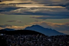 Beautiful view down on the city, clouds and mountains royalty free stock images